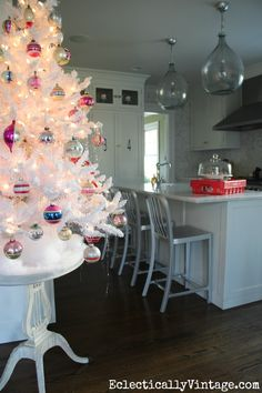 Fun flocked white Christmas tree in the kitchen! eclecticallyvintage.com