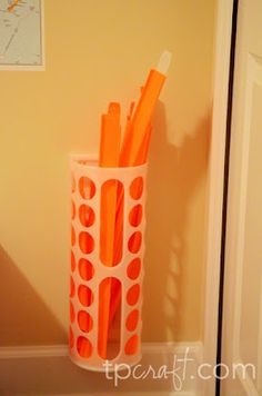 Great storage for the kids car tracks - ikea plastic bag holder