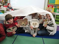 the mitten act out the story using masks and a large sheet to represent the mitten