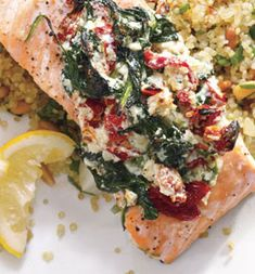 Salmon with ricotta, sun dried tomatoes, and spinach on top of quinoa pilaf with pine nuts.