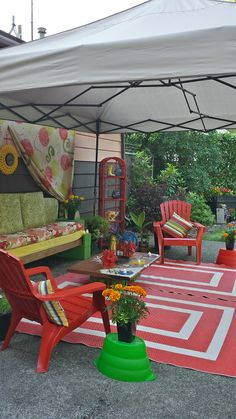 ugly patio make over, furniture furniture revivals, gardening, home decor, lawn care, The cinder block couch Drop cloth curtain