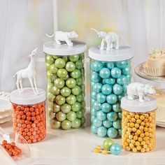 Spray paint the animals, yellow and gray, use as ballon weights, then can go into Babies room as decoration, can hold barretts etc later    Toy Animal Jars - OrientalTrading.com