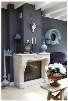 Gorgeous Belgium fireplace, architectural details and slate grey walls (image from Mart)