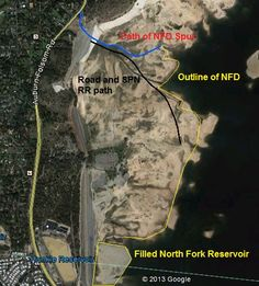 Aerial image of historic structures in low water level Folsom Lake. North Fork Ditch, railroad grade.