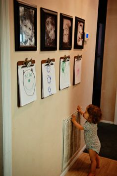 Art wall: clipboard for each child beneath their photo