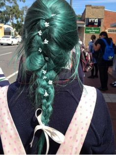 The little flowers accentuate the hair color.