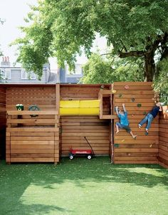 GENIUS privacy wall turned play structure.  Gottesman Residential Real Estate