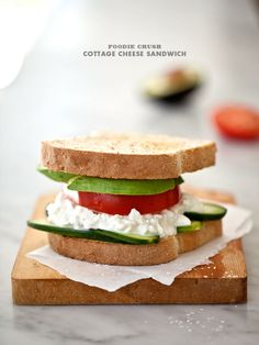 A Simple Cottage Cheese Sandwich  Serving Size: 1 sandwich    Ingredients    2 slices wheat bread  1 tablespoon butter  1/3 cup cottage cheese  1 slice tomato  1/2 avocado, sliced  4 slices cucumber  salt and pepper