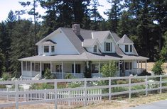 I love wrap around porches.. love the garden and pine trees. If the ocean is nearby then this is where I want to live!