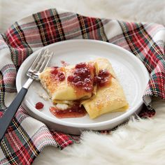 Ricotta Blintzes with Lingonberry Syrup // More Terrific Ricotta Recipes: http://www.foodandwine.com/slideshows/great-ricotta-recipes/ #foodandwine