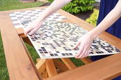 This is a brilliant DIY project! It's an outdoor mosaic top table that converts to a checkers table. Click through for the tutorial by Ashley Phipps of Simply Designing. || @SimplyDesigning