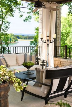 Tall candle stand for outdoor living...  interior design client at Lake Keowee, SC : Linda McDougald Design | Postcard from Paris Home