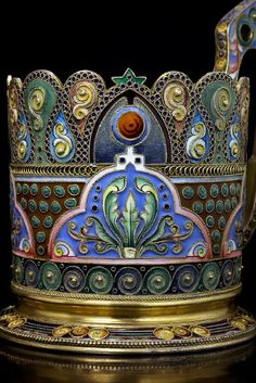 gilded silver and shaded cloisonne enamel antique Russian tea glass holder by the 11th Artel, made in Moscow between 1908 and 1917, decorated in the Modern style of the 1910s