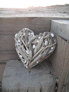 shell, stick, driftwood art, driftwood heart, at the beach