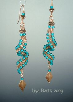 Copper wire with seed beads.  Fun little ear rings.