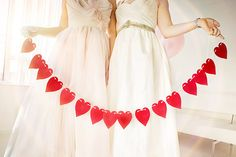 Red Heart Garland | Maru Photography | http://heyweddinglady.com/glamorous-red-white-blush-wedding-inspiration-time-valentines-day/