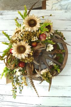 Wreath FREESHIPPING XL Antique Wheel Antler Sunflowers Pheasant feathers Western Burlap Wreath Ranch Prairie Boutique Designer wreath on Etsy, $242.00