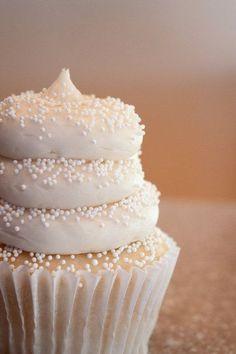 White frosting with white sprinkles on a white cupcake - so cute #wedding #weddingcupcake #cupcake #white #whitecupcake