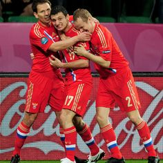 Alan Dzagoev of Russia (C) celebrates scoring the opening goal with team-mates during their UEFA EURO 2012 Group A match against Czech Republic