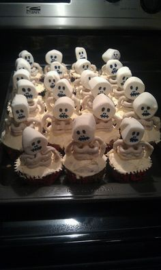 zombie skeleton cupcakes made out of white chocolate pretzels and marshmallows