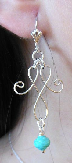 Silver Plated Fancy Wire Handmade Earrings by bsueboutiquesjewelry, $14.95  made by Javi....love this little bead!
