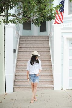 Blogger Crystalin Marie styles her Gap oxford shirt with a panama hat and ripped jean shorts.