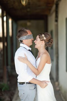 Blindfold him, give him a kiss, and still don't let him see you till the aisle!  No taking the blindfold off!!