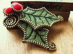 Zip edged wool felt holly brooch