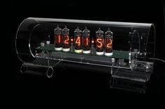 """One of the first types of digital displays, Russian-made """"nixie tubes"""" involving cold cathode tubes, neon gas and loads of stuff i don't understand. But it looks cool."""
