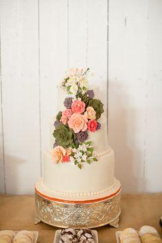 wedding cake embellished with roses and succulents #succulent #weddingdessert #whitecake