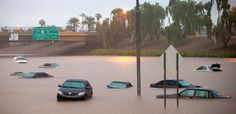 Cars are stuck in flood waters on I-10 east at 43rd Ave. after monsoon rains flooded the freeway in Phoenix, Sept. 8, 2014.