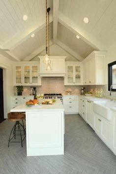 Amazing kitchen with vaulted ceiling, & gray chevron herringbone pattern wood floors. OMG.