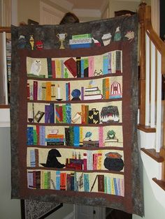 Finished Harry Potter bookcase quilt.