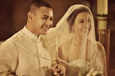 The ritual of placing the 2 looped chord in a figure 8 shape around the couple signifying their eternal love  filipino wedding ceremony traditions: nevris