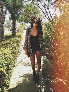 black romper or dress. floral oversized cardi.