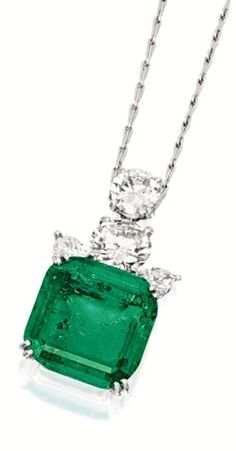 Emerald and diamond pendant necklace, CARTIER.  Suspending a step-cut emerald weighing 17.92 carats, surmounted by brilliant-cut diamonds weighing approximately 2.35 and 1.30 carats respectively, decorated by marquise-shaped diamonds, mounted in 18 karat white gold, accompanied by a gold link chain, length approximately 480mm, signed and numbered 34307. Via Sotheby's.