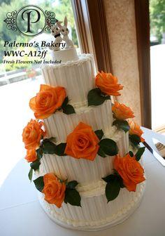 orange roses on white cake
