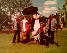 Vintage photo of Mary Poppins, Mr. Penguin and the chimney sweeps at Walt Disney World