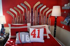 Ultimate hockey room! Hockey pucks for lamp posts. Hockey sticks for headboard. Vintage locker room baskets as organizers. Jerseys for pillow cases.