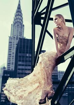 Love this strapless gold dress, looks like a mermaid in the air #weddingdress #outerdress wedding dressses, colored wedding dresses, jessica stam, dress wedding, the dress, new york fashion, fashion photography, chrysler building, empire state