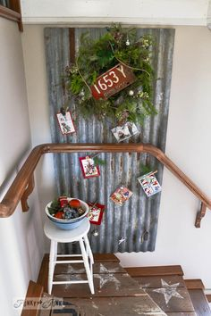 Metal siding Christmas card holder / Funky Junk Interiors Christmas Home Tour 2013 via www.funkyjunkinte...