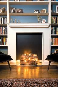 Living room ideas - christmas lights in the fireplace. Originally from: Tvia - Time Out Chicago faux fireplace, fireplaces, fake fireplace, christmas lights, string lights, nonwork fireplac, hous, design blogs, decor idea