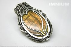 Double sided labradorite hybrid pendant - polished stone wrapped in sterling silver. Unique wire wrap orange vibrant sunny tropical colors