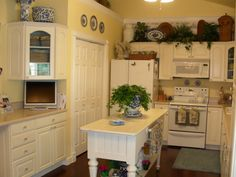French Country Kitchen . I love the island table.