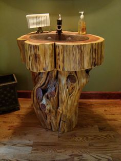 Rustic log vanity created from eastern red cedar with copper sink