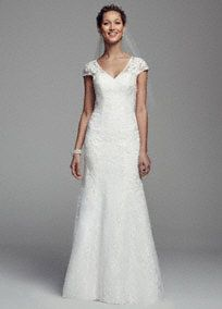This cap sleeve all over lace gown was designed with vintage style and grace in mind!  Cap sleeve bodice features all over deicate lace detail.  Open back creates a stunning focal point.  Trumpet skirt adds dimension and drama.  Available online in Soft White. Sizes 0-14. Fully lined. Back zip. Imported. Dry clean. To preserve your wedding dreams, try our Wedding Gown Preservation Kit.