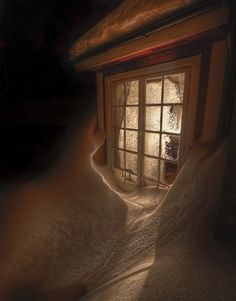 Snowdrift right up to the window.  Love to be inside there...