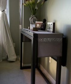 Black solid wood console table that converts to dining table