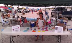 Local artist and entrepreneur Kenzie Allen at her booth selling Kenzie's Artistic Kreations.