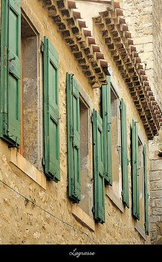 green shutters and stone walls